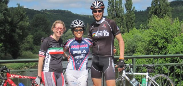 Cycling along the Vezere River with three cyclists