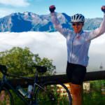 Conquered Alpe d'Huez woman above the clouds