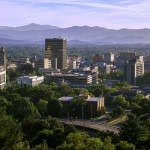 outfitter bicycle tours cityscape of Asheville North Carolina in the Blue Ride Mountains